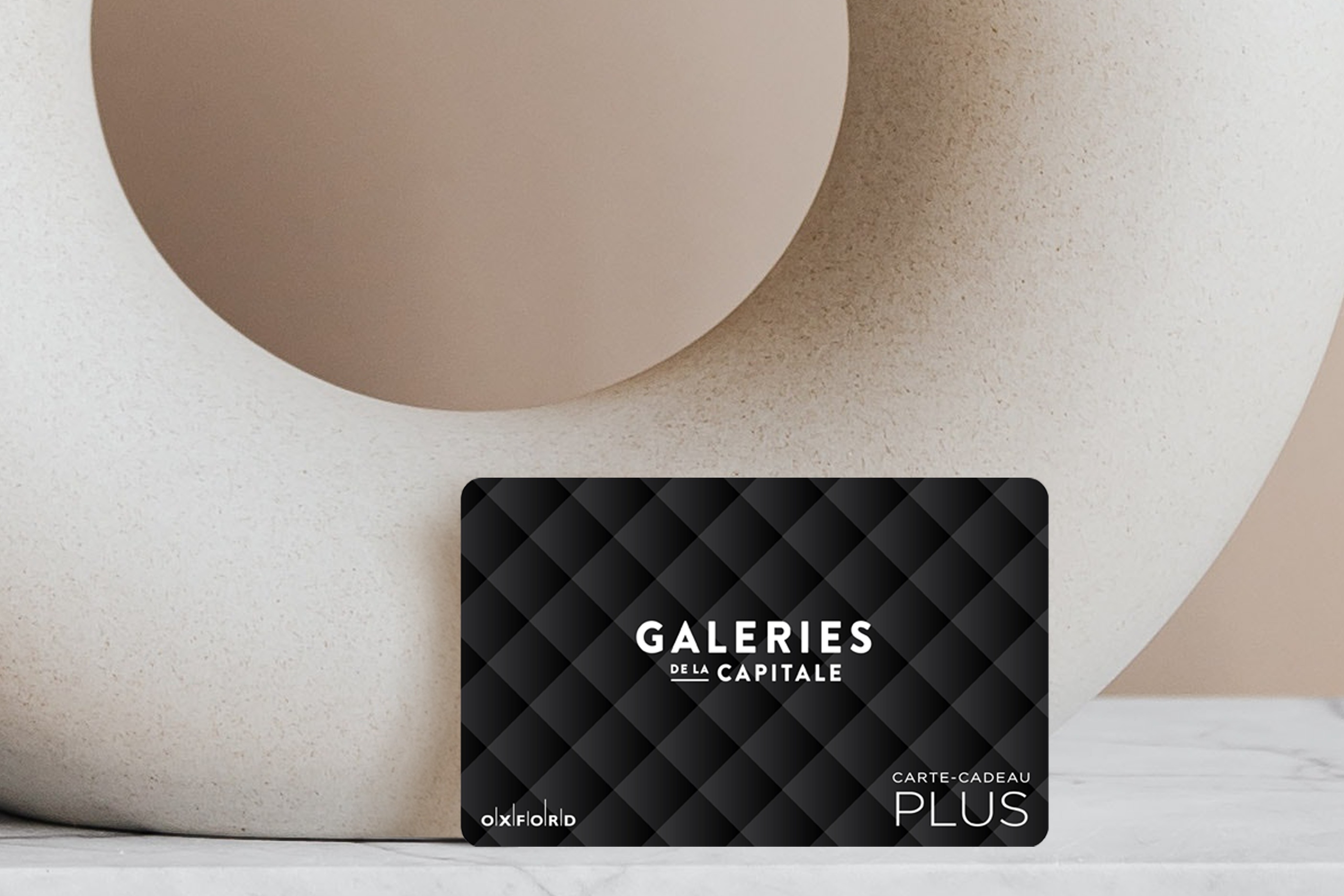 Capitale black gift card with beige circular vase.
